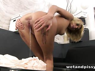gaudy blonde pleasuring herself