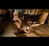 Brunette slut in bondage gets her tight ass explored by a blonde
