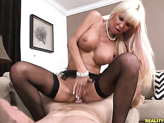 mature blonde wearing pearl