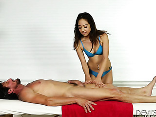 cute asian masseuse gives